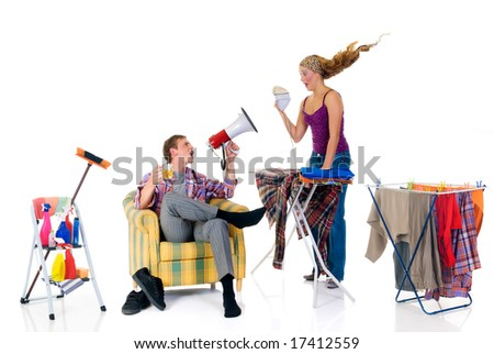 Young bossy man with megaphone,  woman ironing clothing. Studio, white background.