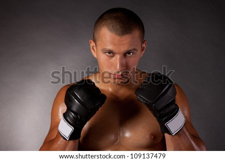 Young Boxer fighter over black - stock photo