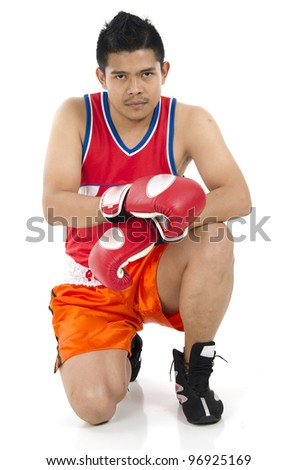 Young boxer poses in sitting position. - stock photo