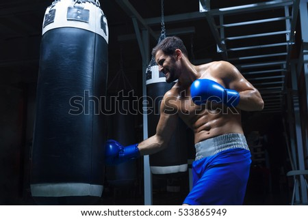 Young boxer with sports pear