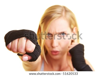 Young boxing woman with black hand bandage - stock photo