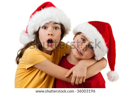 Young boy and girl as Santa Claus isolated on white background