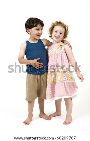 young boy and girl couple isolated on  white