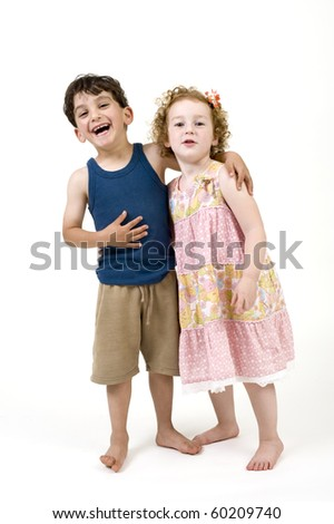 young boy and girl couple isolated on  white - stock photo