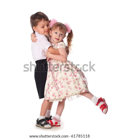 young boy and girl dancing isolated on white - stock photo
