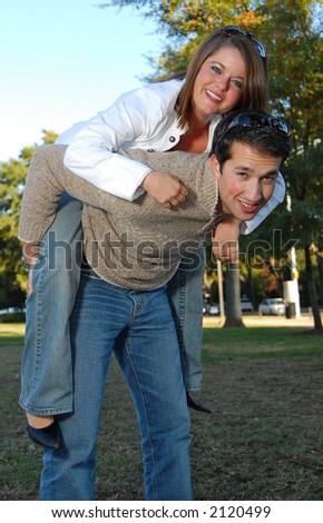 young boy and girl piggy back riding