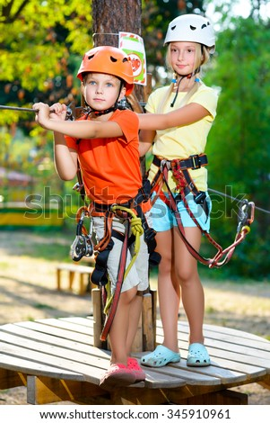 Young boy and girl playing when having fun doing activities outdoors. Happy childhood concept. Warm toned image