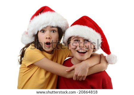 Young boy and girl wearing Santa's hat isolated on white background