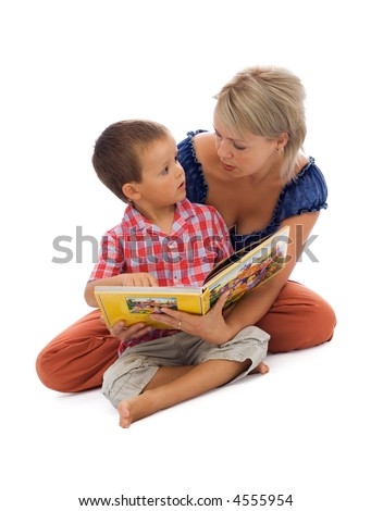 Young boy and his mother reading a story together - isolated on white with a bit of shadow