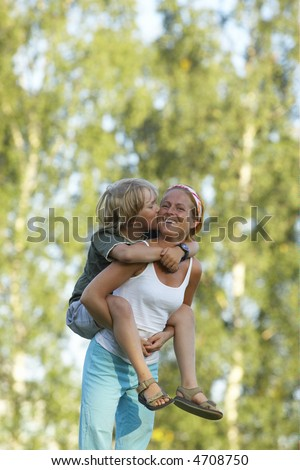Young boy and mom - stock photo