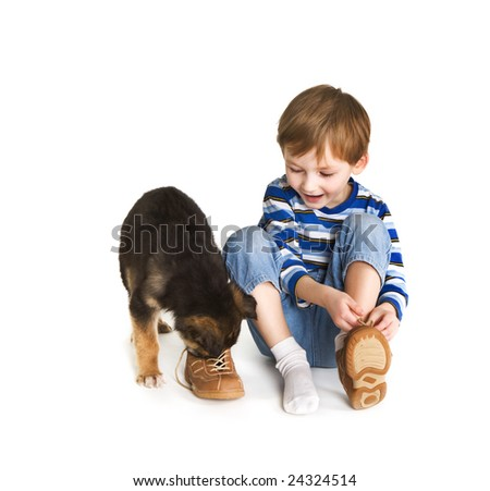 Young boy and puppy - stock photo