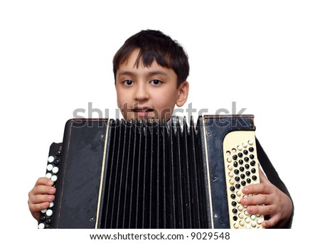 young boy asian boy plays on accordion - stock photo