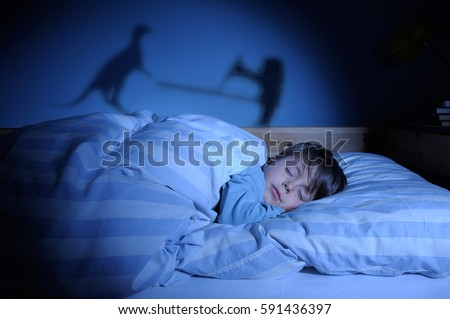 young boy asleep his bed having stock photo shutterstock young boy asleep in his bed having scary nightmares dragon and warrior
