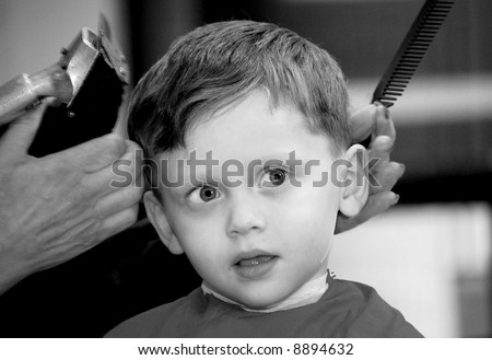 Young Boy at Barber - stock photo