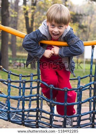 young boy at playground - stock photo