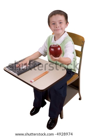 Young boy at school desk giving an apple to the teacher with book and pencils isolated over a white background - stock photo