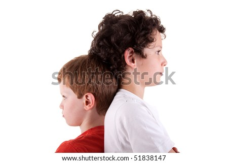 Young boy back to back, isolated on white background. Studio shot - stock photo