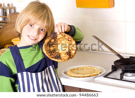 young boy baked pancakes