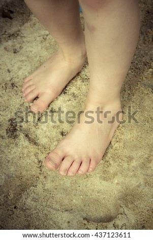 young boy barefoot