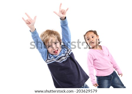 Young boy being wild while a girl watches - stock photo