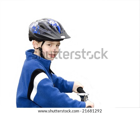 Young boy bike rider wearing helmet isolated against white background - stock photo