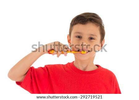 Young Boy brushing teeth, isolated on white background - stock photo