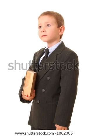 Young boy businessman carrying book