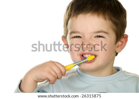 Young boy cleans a teeth - stock photo