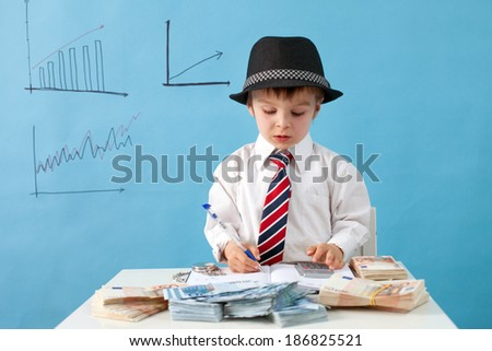 Young boy, counting money and taking notes - stock photo