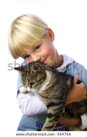 Young boy cuddling pet cat - stock photo