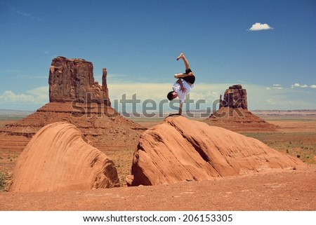 Young boy dancing in Monument Valley