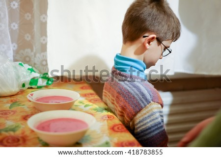 young boy does not want to eat