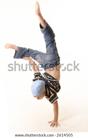 Young boy doing a one handed handstand with a white background - stock photo