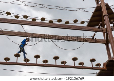 Young boy doing an obstacle course - stock photo