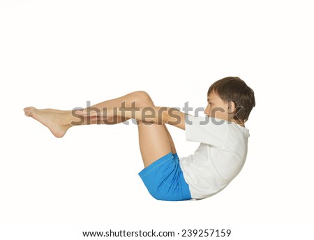 Young boy doing exercises, isolated on white background