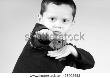 Young boy doing superpower maneuver - stock photo