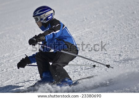 Young boy downhill skiing