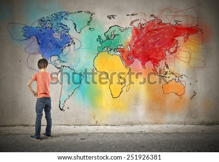 Young boy drawing a world map  - stock photo