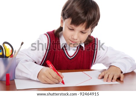 young boy drawing house isolated on white - stock photo