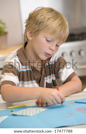 Young Boy Drawing Pictures