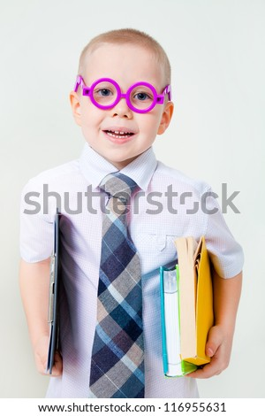 young boy dreams of becoming a businessman - stock photo