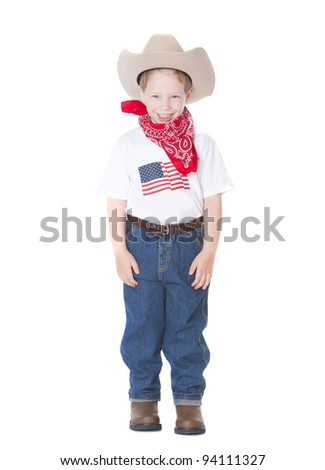 Young boy dressed as a cowboy on white background - stock photo