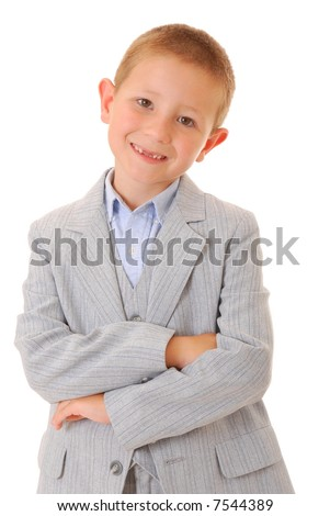 Young boy dressed formally wearing a suit