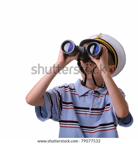 young boy dressed like a sailor looking into a binoculars isolated on white - stock photo
