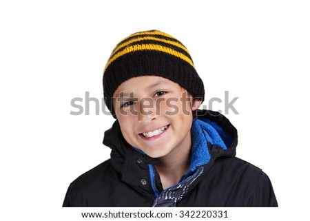 Young boy dressed up for winter - isolated on white