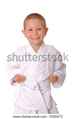 Young boy dressed wearing a karate outfit - stock photo