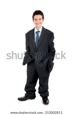 Young boy dressed with a big man's suit - stock photo