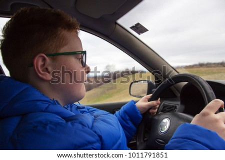 Young boy driving