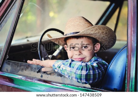 Young boy driving old truck