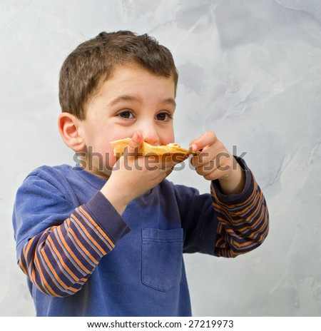 young boy eating homemade pizza - stock photo